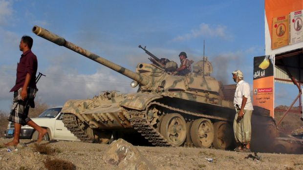 Troops loyal to Yemen's President take positions on the frontline.