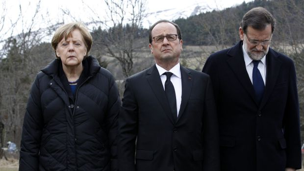 German Chancellor Angela Merkel, left, French President Francois Hollande, centre, and Spanish Prime Minister Mariano ...