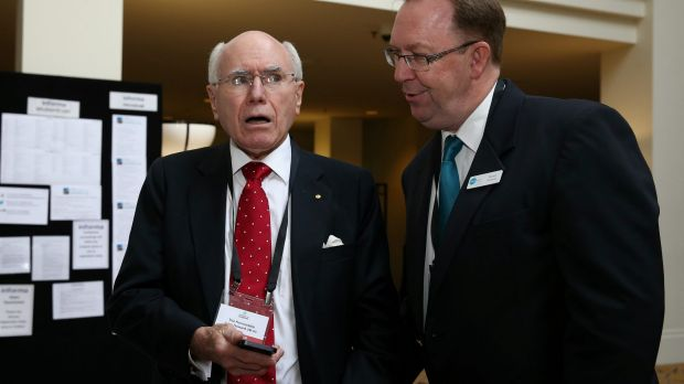 Steps Group Australia executive officer Stuart Coward shows former prime minister John Howard the fake Facebook page.