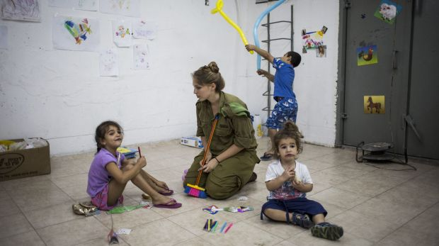 """Indiscriminate attacks"": Israeli children sit in a bomb shelter in Ashkelon during the 2014 Israel-Gaza conflict."