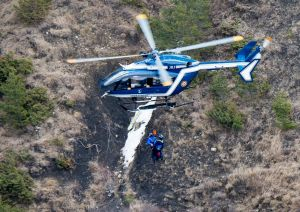 Rescue workers being rappelled from an helicopter on the crash site near Seyne-les-Alpes, French Alps on Wednesday, ...