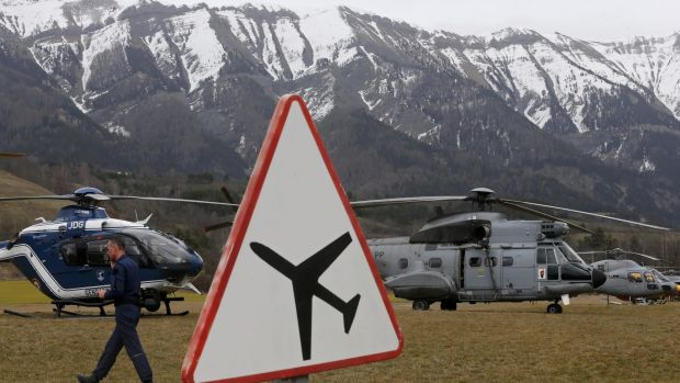 Rescue helicopters from the French authorities in front of the Alps during a rescue operation next to the crash site of ...
