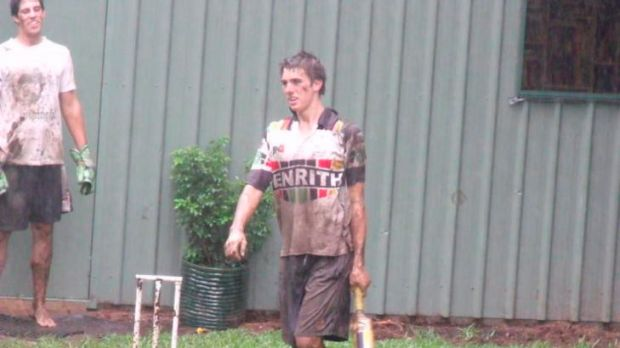 Backyard star ... Pat Cummins playing cricket with his family.