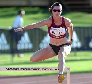 Canberra athlete Lauren Wells on her way to winning the women's 400m hurdles at the Australian Athletics Championships ...