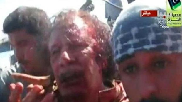 Bloody end ... in this still image provided by Reuters TV, a man believed to be Muammar Gaddafi, is pulled from a truck ...