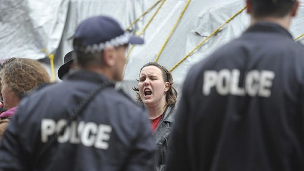 A protester shouts at police.