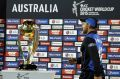 Not this year: Brendon McCullum, named in the ICC team of the tournament, walks past the Cricket World Cup trophy after ...