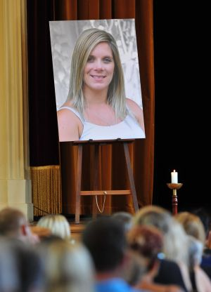 Families and friends attending the funeral for Tara Costigan on March 11.