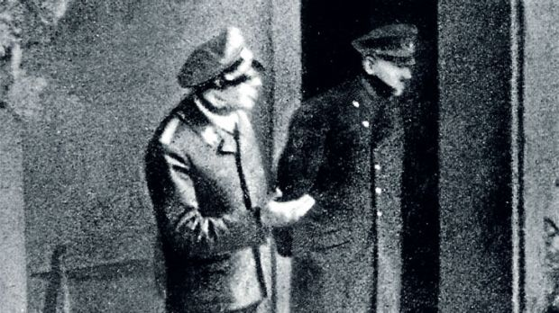 Hitler inspects bombing damage in one of the final photographs taken before his suicide in 1945.