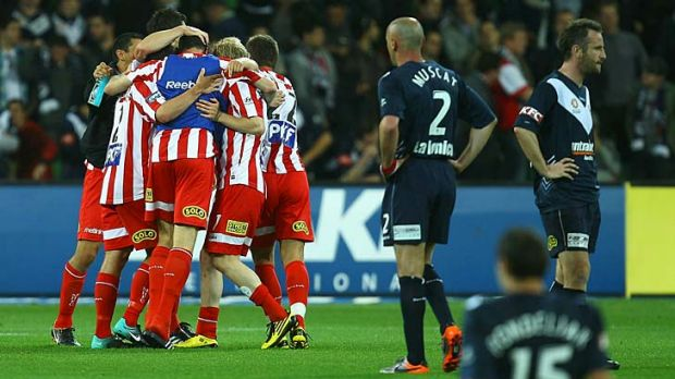 Melbourne Heart players celebrate after winning the round nine match against Melbourne Victory last year.