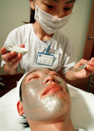 Men are increasingly being hopping on the beauty bandwagon. A man in Beijing receives treatment at the first men's ...