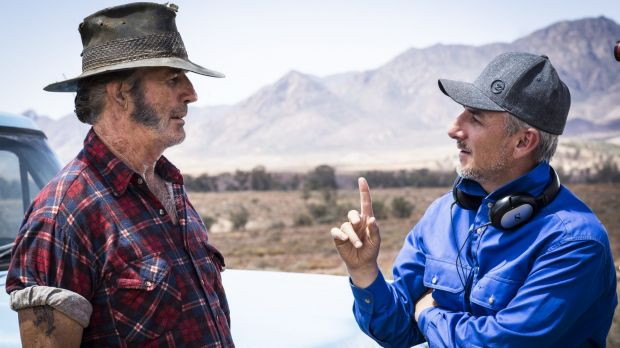 Taking the Mick ... Director Greg McLean (right) on the set of <i>Wolf Creek 2</i> with John Jarratt.