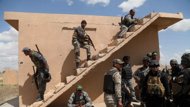 Iraqi security forces and allied Shiite militiamen prepare to attack Islamic State extremists in Tikrit.