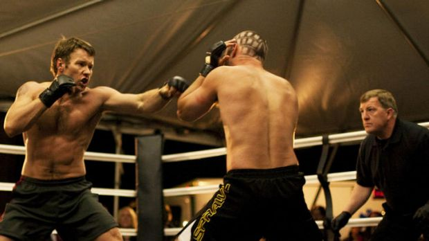 I'll hit you like a brother: Joel Edgerton (left) smacks it out in the mediocre fight film <i>Warrior</i>.