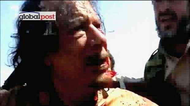 Last moments of a tyrant: Former Libyan leader Muammar Gaddafi after his capture by NTC fighters.