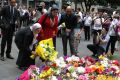 SYDNEY, AUSTRALIA - DECEMBER 16:  Members of the Muslim community lay flowers at Martin place after 2 people and gunman ...