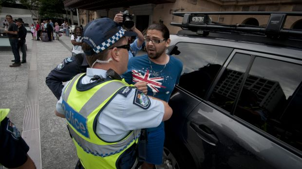 Police issued two protesters with move on directions and charged one for public nuisance.