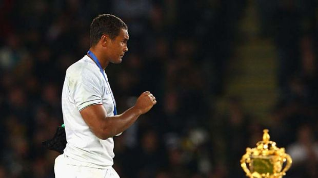 So near to glory ... man of the match Thierry Dusautoir of France walks past the Webb Ellis Trophy.
