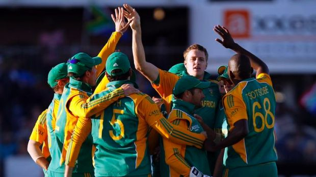 Morne Morkel of South Africa (second from right) celebrates the wicket of Australian captain Michael Clarke.