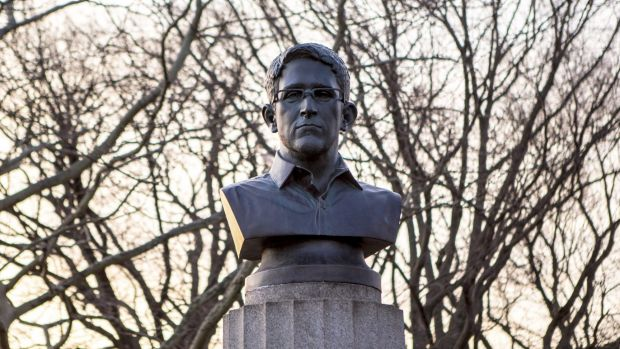 The bust of the former US spy agency contractor in the hours before it was removed on Monday.