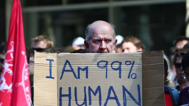 Figure of discontent ... a protester holds up a placard at the Occupy Sydney rally.