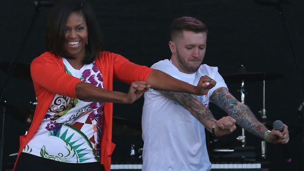 Michelle Obama dances with members of the All Stars from the television show So You Think You Can Dance during the ...