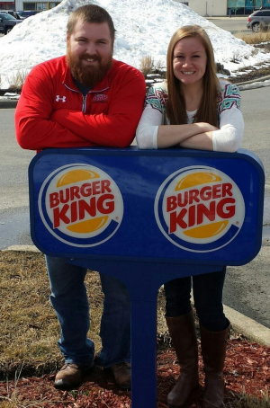 The couple posed in front of a Burger King sign for their engagement announcement.