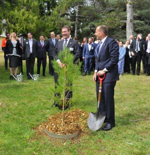 Prime Minister Tony Abbott plants a sapling with Ian Irving, chief executive for Australia, Northrop Grumman, at the ...