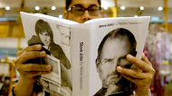 Eric Calderon, an Apple fan who said he owns most of the company's products, browses through the biography of Steve ...