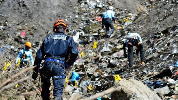 French emergency rescue services work at the crash site.