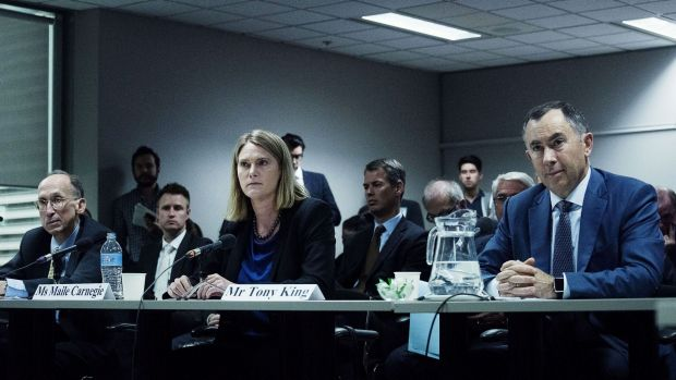 Public hearing: From left, Bill Sample, corporate vice-president of Microsoft worldwide tax, Maile Carnegie, managing ...