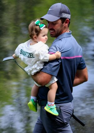 Charl Schwartzel of South Africa with his daughter.