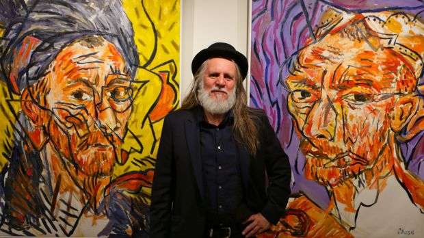 Artist George Gittoes at his 2014 exhibition, Vincent and the Snow Monkey, at Sydney's Art  Equity gallery.