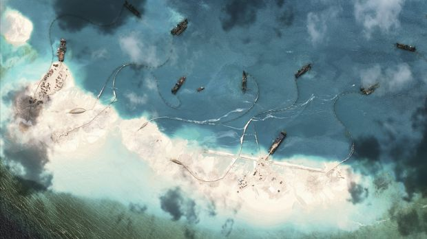 A satellite image shows dredgers at work in the South China Sea.