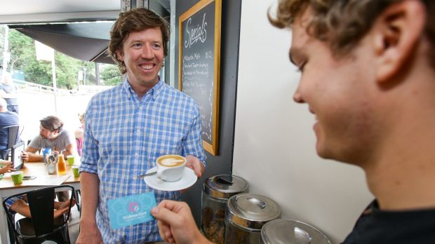 Former Sydney marketing executive Jono Fisher (left) purchased a coffee for a stranger as part of those leading a charge ...