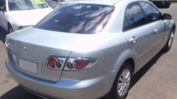 The vehicle Julie Hutchinson may have been driving, a 2004 silver, Mazda6 sedan with Queensland registration 622-HZE ...