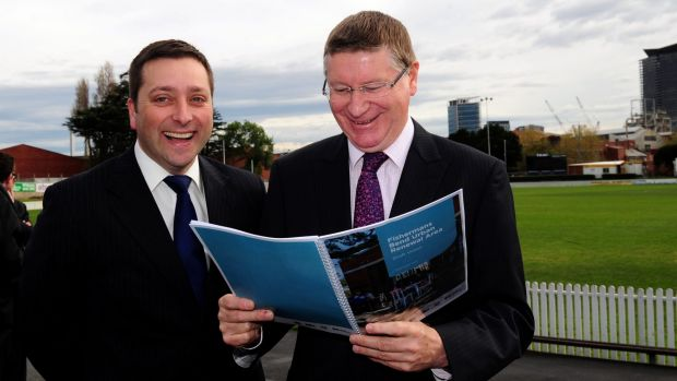 Former premier Denis Napthine (right) and now Opposition Leader Matthew Guy unveil the initial plans for Fishermans Bend ...
