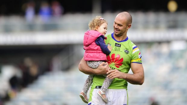 Canberra Raiders player Dane Tilse with daughter Ila after playing his 200th game and his last home game for the ...