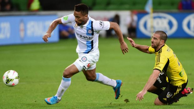 Harry Novillo of Melbourne City gets away from Manny Muscat of Wellington Phoenix during the A-League match on Sunday.