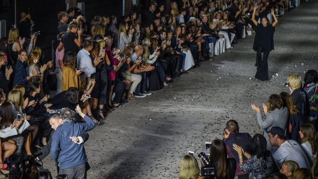 Close call: Security stopped a man from running onto the catwalk as designer Kym Ellery took a bow at the end of the ...