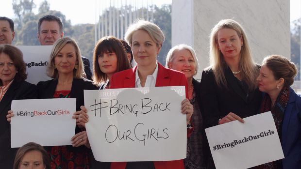 Concerned MPs, including Shadow foreign minister Tanya Plibersek, display #bringbackourgirls signs outside Parliament ...