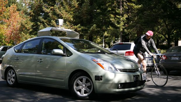 A self-driving car developed and outfitted by Google, with device on roof, at Google headquarters in Mountain View, ...