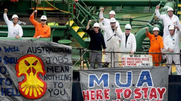 Defiant ... crew members of the Araluen Spirit at Shell's Gore Cove terminal yesterday. Shell promised talks with the ...