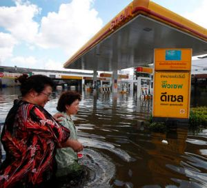 A muddy tide besieges a petrol station.
