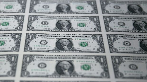 Dollar tumbles to 7-month low after weaker-than-expected U.S