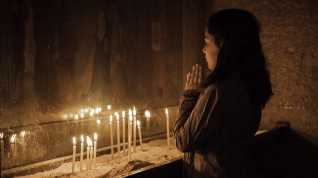 A Damascus woman prays in St Sarkis.