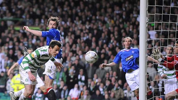 Jan Vennegoor of Hesselink scores the winning goal for Celtic against Rangers during a Scottish Premier League match in 2008.