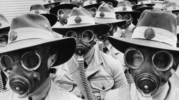 Australian soldiers sport gas masks in World War II.
