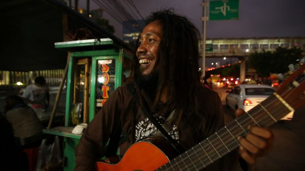 Bambang 'Ho' Mulyono performs on the streets of Jakarta. He is one of three buskers who feature in the documentary ...