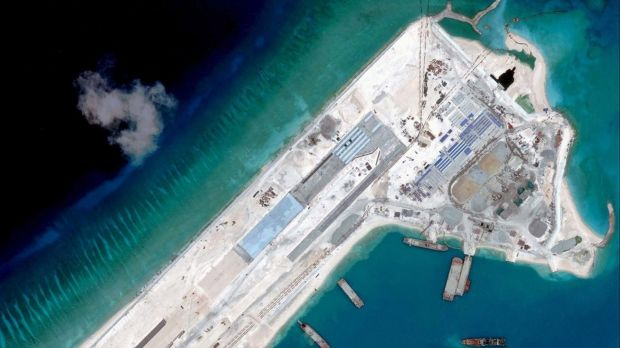 Reclamation: A satellite image taken in April shows a Chinese airstrip under construction on Fiery Cross Reef in the ...